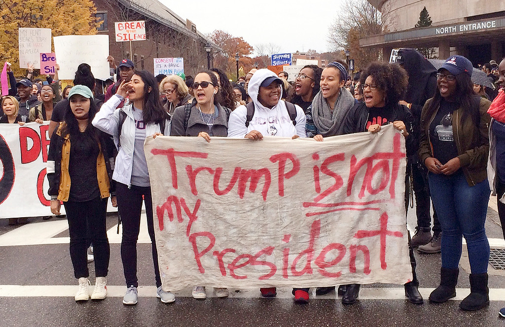. People protest on the University of Connecticut campus against the election of Republican Donald Trump as President Wednesday, Nov. 9, 2016, in Storrs, Conn. (AP Photo/Pat Eaton-Robb)