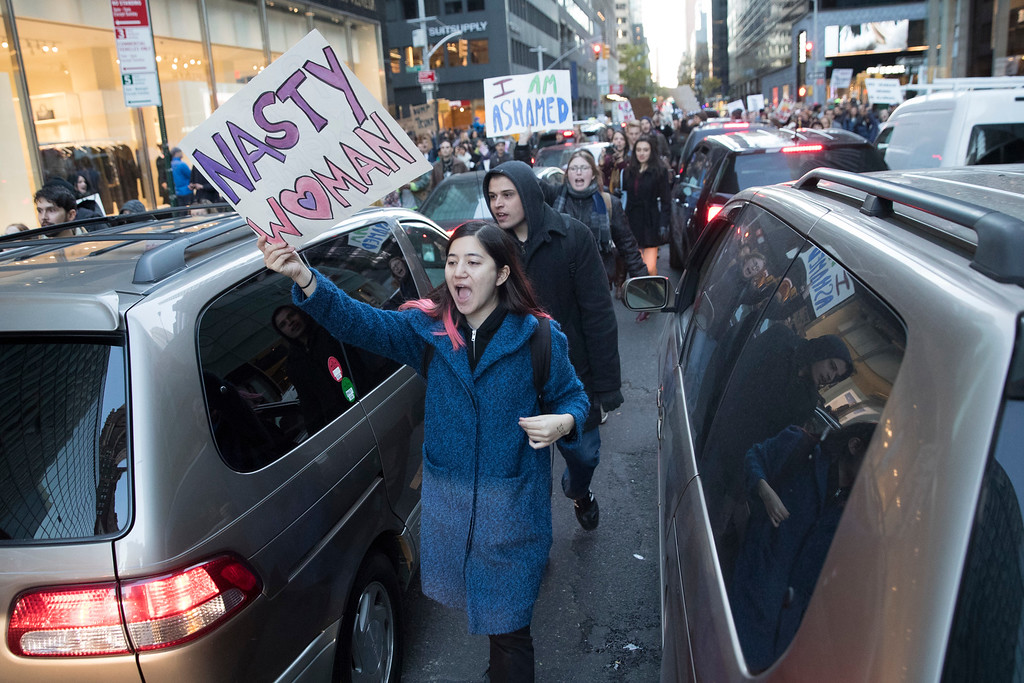 . Protestors walks through the streets after breaking off from a rally outside Trump Tower in New York on Saturday, Nov. 12, 2016, to protest against President-elect Donald Trump. (AP Photo/Mary Altaffer)