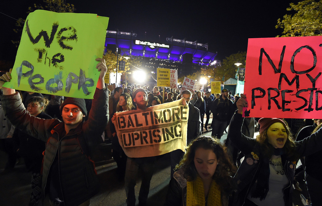 . Anti-Trump protesters make their way to M&T Bank Stadium during the Baltimore Ravens vs. Cleveland Browns football game Thursday, Nov. 10, 2016, in Baltimore. Scattered protests around the country continue to follow the unexpected election of Donald Trump as president, with hundreds marching in Philadelphia, Baltimore and Grand Rapids, Mich. (Lloyd Fox/The Baltimore Sun via AP)