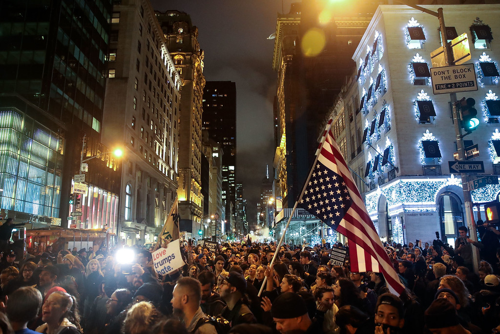 . NEW YORK, NY - NOVEMBER 9: Protestors flood Fifth Avenue as they rally against Donald Trump outside of Trump Tower, November 9, 2016 in New York City. Republican candidate Donald Trump won the 2016 presidential election in the early hours of the morning in a widely unforeseen upset. (Photo by Drew Angerer/Getty Images)
