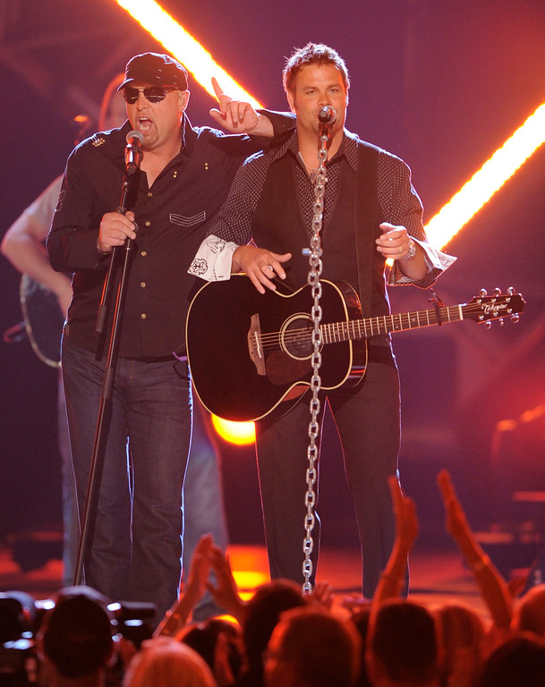 . Eddie Montgomery, left, and Troy Gentry of Montgomery Gentry perform at the 43rd Annual Academy of Country Music Awards on Sunday, May 18, 2008, in Las Vegas. (AP Photo/Mark J. Terrill)