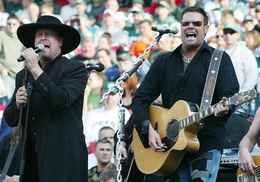 . File - Eddie Montgomery, left, and Troy Gentry, right, of the country western group Montgomery Gentry, perform during the half time show at the San Diego Chargers and New York Jets game in East Rutherford, N.J. on Sunday, Nov. 6, 2005. (AP Photo/Tim Larsen)