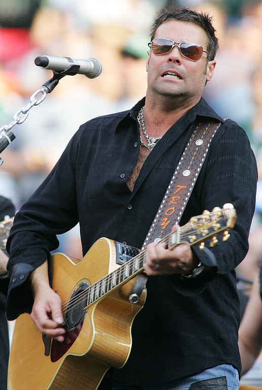 . File - Troy Gentry of the country western group Montgomery Gentry performs during the half time show at the San Diego Chargers and New York Jets game in East Rutherford, N.J. on Sunday, Nov. 6, 2005. Gentry, one half of the award-winning country music duo Montgomery Gentry, died Friday, Sept. 8, 2017, in a helicopter crash, according to a statement from the band�s website. He was 50.  The group was supposed to perform Friday at the Flying W Airport & Resort in Medford, N.J. (AP Photo/Tim Larsen)