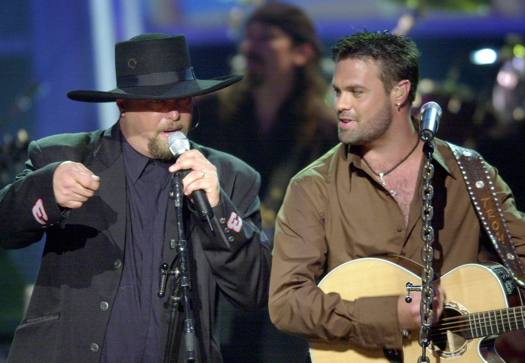 . File - Eddie Montgomery, left, and and Troy Gentry, of the group Montgomery Gentry, perform at the 36th annual Academy of Country Music Awards Wednesday, May 9, 2001, in Los Angeles. Montgomery wears the number \'3\' on his sleeves in tribute to NASCAR driver Dale Earnhardt. (AP Photo/Kevork Djansezian)