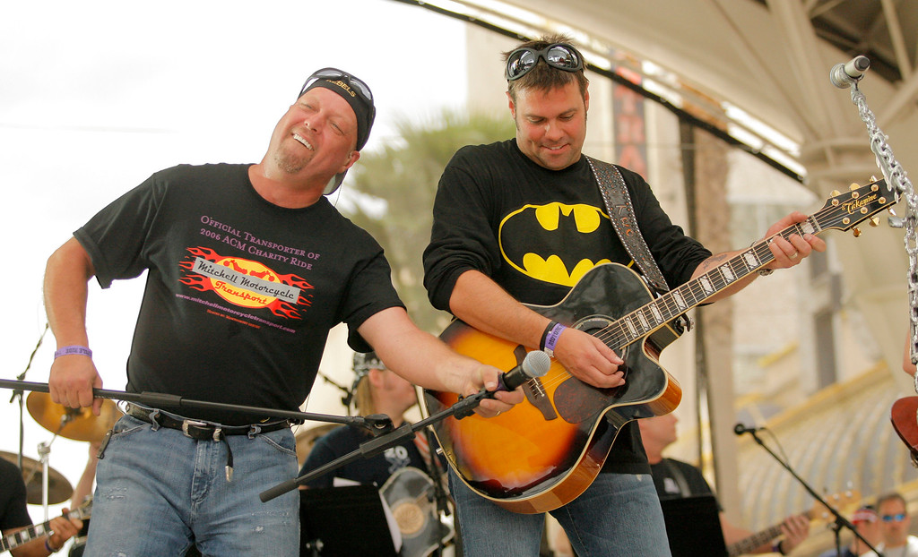 . Troy Gentry, right, and Eddie Montgomery, left, of Montgomery Gentry perform at the Fremont Street Experience in downtown Las Vegas, Sunday, May 21, 2006.   (AP Photo/Jae C. Hong)
