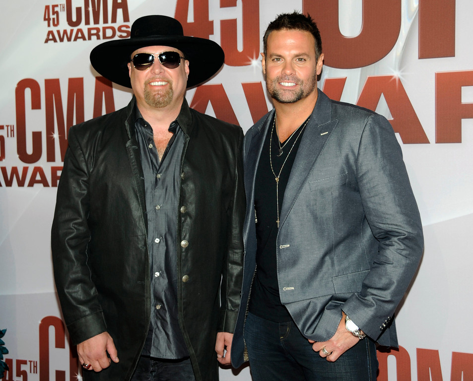 . FILE - In this Nov. 9, 2011 file photo, Eddie Montgomery, left, and Troy Gentry of Montgomery Gentry arrive at the 45th Annual CMA Awards in Nashville, Tenn. Gentry, one half of the award-winning country music duo Montgomery Gentry, died Friday, Sept. 8, 2017, in a helicopter crash, according to a statement from the band�s website. He was 50.  The group was supposed to perform Friday at the Flying W Airport & Resort in Medford, N.J. (AP Photo/Evan Agostini, File)