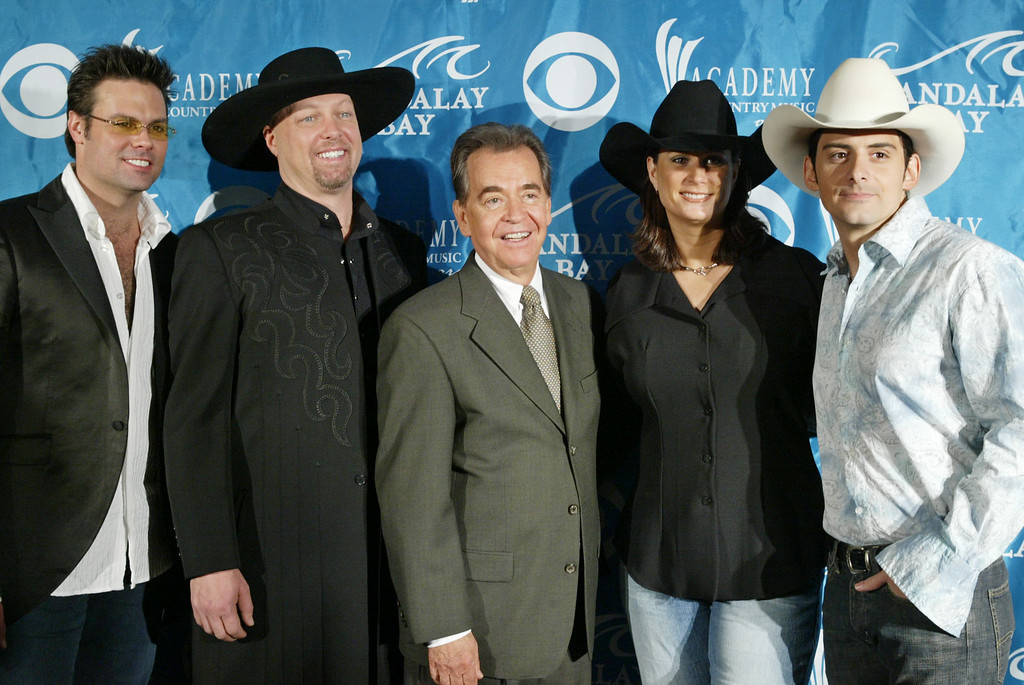 . File - From left, singer Troy Gentry, singer Eddie Montgomery,  producer Dick Clark, singer Terri Clark and singer Brad Paisley are seen during the nomination announcement for the Academy of Country Music Awards in Los Angeles  Wed., March 10, 2004.  (AP Photo/Nick Ut)
