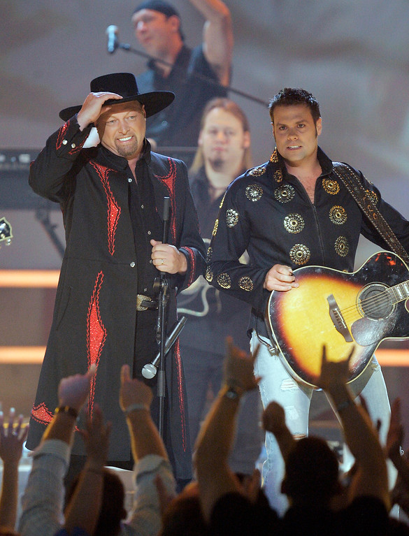 . File - Eddie Montgomery, left, and Troy Gentry, of the country duo Montgomery Gentry, perform during the Academy of Country Music Awards on May 23, 2006, in Las Vegas.  (AP Photo/Mark J. Terrill)