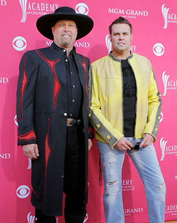 . File - Eddie Montgomery, left, and Troy Gentry, of the nominated duo Montgomery Gentry pose for photographers as they arrive for the 41st Academy of Country Music Awards, in this file photo from May 23, 2006, in Las Vegas.   (AP Photo/Jae C. Hong-File)