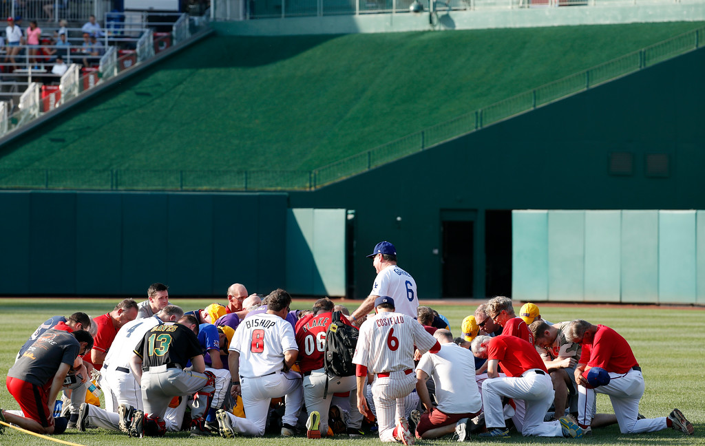 . Steve Garvey, former Los Angeles Dodgers player, leads a prayer for the Republican team before the Congressional baseball game, Thursday, June 15, 2017, in Washington. The annual GOP-Democrats baseball game raises money for charity. (AP Photo/Alex Brandon)