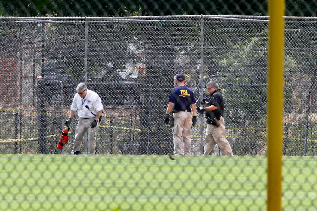 . FBI agents continue to search for evidence on the baseball field in Alexandria, Va., Thursday, June 15, 2017, the day after House Majority Whip Steve Scalise of La. was shot during during a congressional baseball practice. (AP Photo/Jacquelyn Martin)