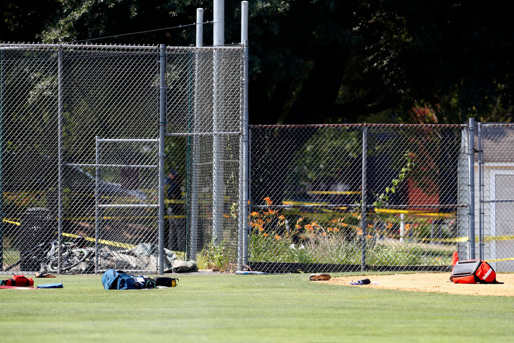 . Equipment and medical bags are seen on the baseball field in Alexandria, Va., Wednesday, June 14, 2017, after a shooting where House Majority Whip Steve Scalise of La., and others were shot during a congressional baseball practice. (AP Photo/Alex Brandon)