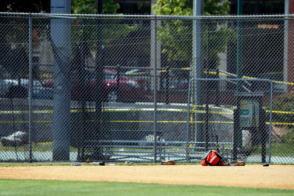 . Equipment is seen on the baseball field in Alexandria, Va., Wednesday, June 14, 2017, that was the scene of a shooting where House Majority Whip Steve Scalise of La., and others, were shot during a congressional baseball practice. (AP Photo/Alex Brandon)