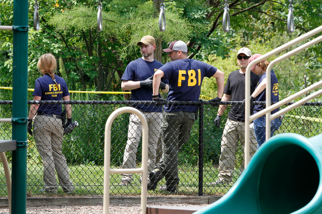 . FBI agents investigate a playground near the baseball field in Alexandria, Va., Thursday, June 15, 2017, the day after House Majority Whip Steve Scalise of La. was shot during during a congressional baseball practice at the park. (AP Photo/Jacquelyn Martin)
