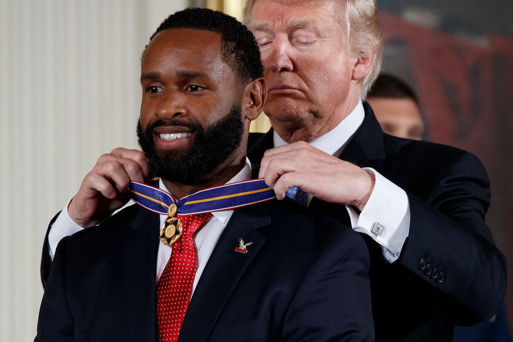 . President Donald Trump presents Capitol Hill police Officer David Bailey the Medal of Valor during a ceremony in the East Room of the White House in Washington, Thursday, July 27, 2017, to recognize the first responders from the June 14 Congressional baseball shooting. (AP Photo/Evan Vucci)
