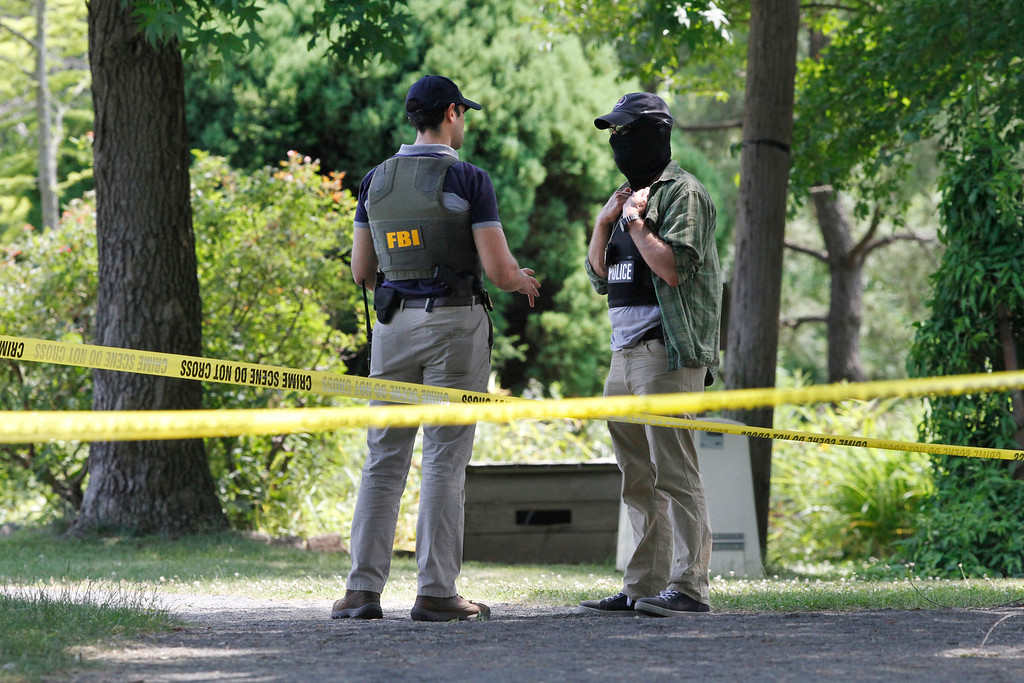 . Law enforcement agents investigate the scene in Alexandria, Va., Thursday, June 15, 2017, the day after House Majority Whip Steve Scalise of La. was shot during during a congressional baseball practice. (AP Photo/Jacquelyn Martin)