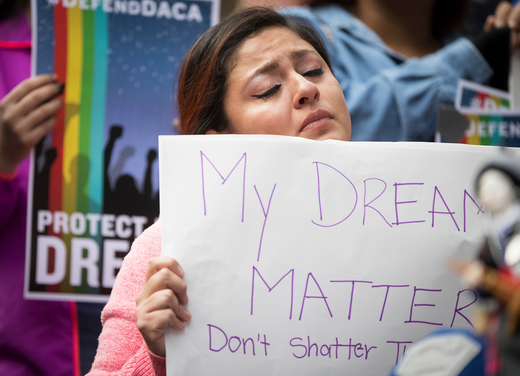 ". Evelin Hernandez cries as she hold a sign reading ""My dreams matter. Don\'t shatter them.\"" at a protest against the announcement that the Trump administration is ending the Deferred Action for Childhood Arrivals program, known as DACA, in Minneapolis, Tuesday, Sept. 5, 2017. Hernandez is a special education paraprofessional and a DREAM act recipient. (Renee Jones Schneider/Star Tribune via AP)"