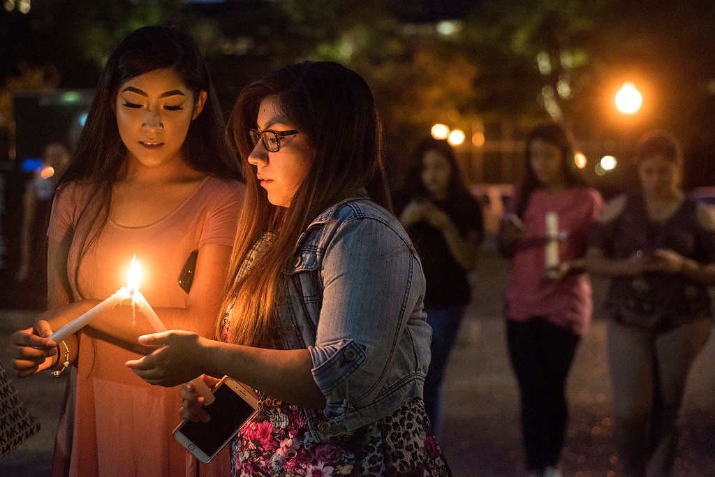. Josselyn and Blanca Villanueva hold candles during a silent vigil in honor of Deferred Action for Childhood Arrivals (DACA) at T.B. Butler Fountain Plaza in Tyler, Texas, on Tuesday, Sept. 5, 2017. Nearly 500 people attended the vigil on the day that the Trump administration announced that they would phase out the program. (Chelsea Purgahn/Tyler Morning Telegraph)