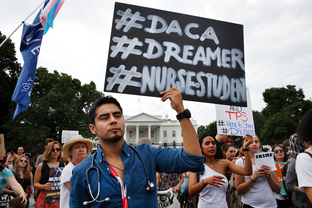 . Carlos Esteban, 31, of Woodbridge, Va., a nursing student and recipient of Deferred Action for Childhood Arrivals, known as DACA, rallies with others in support of DACA outside of the White House, in Washington, Tuesday, Sept. 5, 2017. President Donald Trump will end a program that has protected hundreds of thousands of young immigrants brought into the country illegally as children and call for Congress to find a legislative solution.  (AP Photo/Jacquelyn Martin)