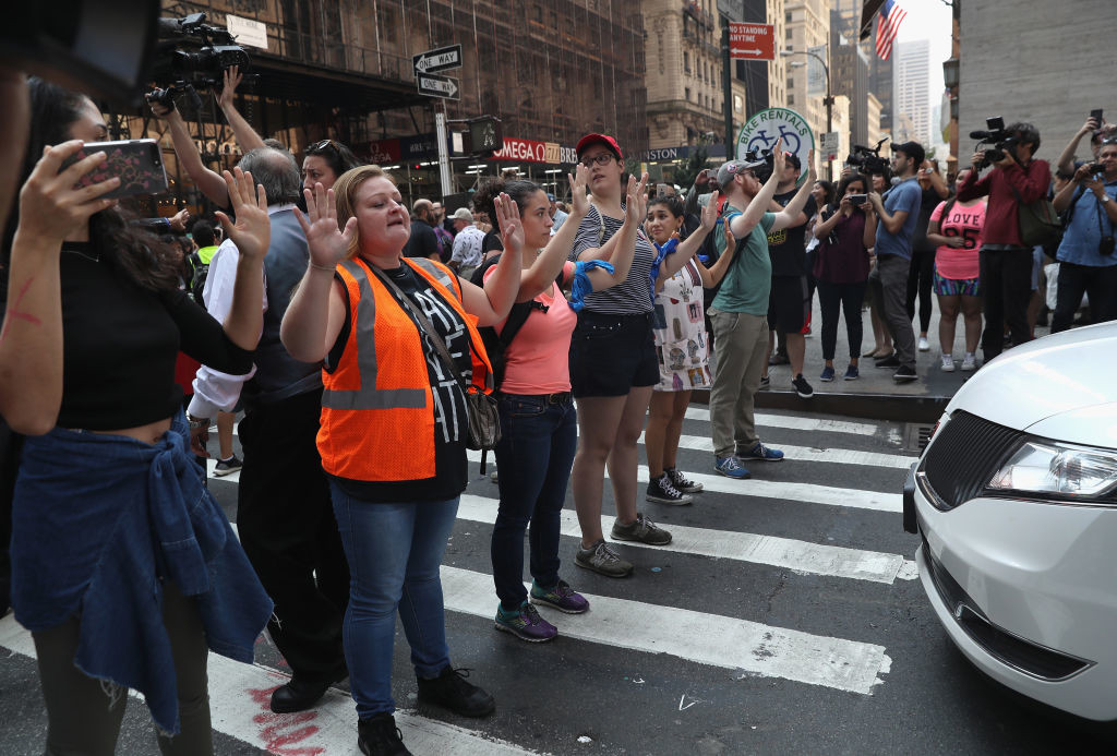 . NEW YORK, NY - SEPTEMBER 05:  Protesters block the street in front of Trump Tower on September 5, 2017 in New York City, United States. The Trump administration announced it is ending the Obama-era DACA program that shields young undocumented immigrants from deportation. Up to 800,000 of them brought to the U.S. illegally as children will face possible deportation when the Deferred Action for Childhood Arrivals (DACA) program is set to expire on March 5, 2018.  (Photo by John Moore/Getty Images)