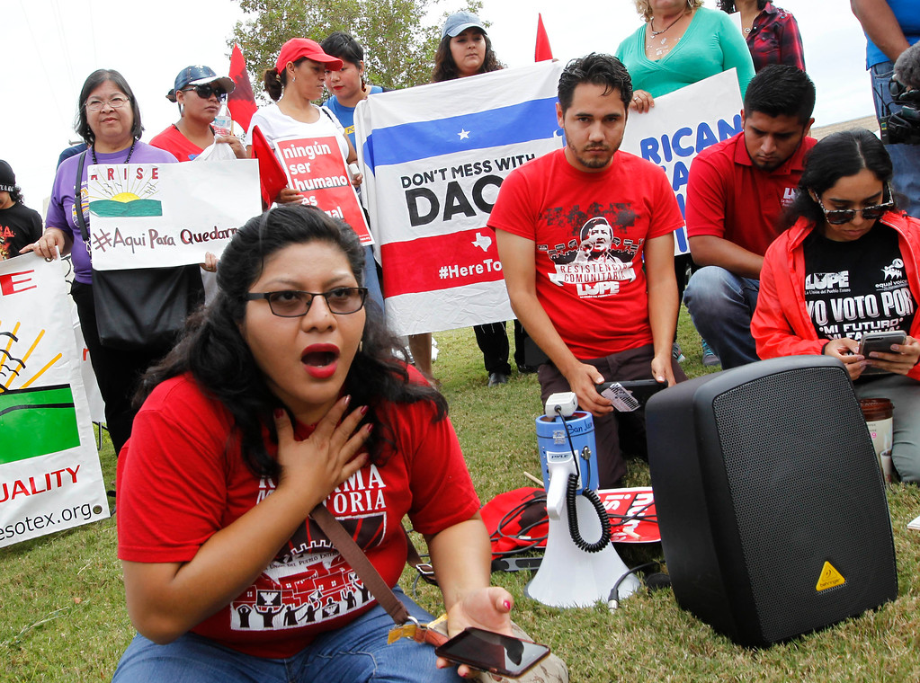 . Tania Chavez, left, reacts as she listens to U.S. Attorney General Jeff Sessions announce the end of the program that protects immigrants who were brought to the U.S. as children, known as DACA, during a gathering in support of the program, Tuesday, Sept. 5, 2017, in front to the Texas Attorney General\'s office in Pharr, Texas. Texas Attorney General Ken Paxton had given the Trump administration until Tuesday to decide if DACA would end or face a legal battle. (Nathan Lambrecht/The Monitor via AP)