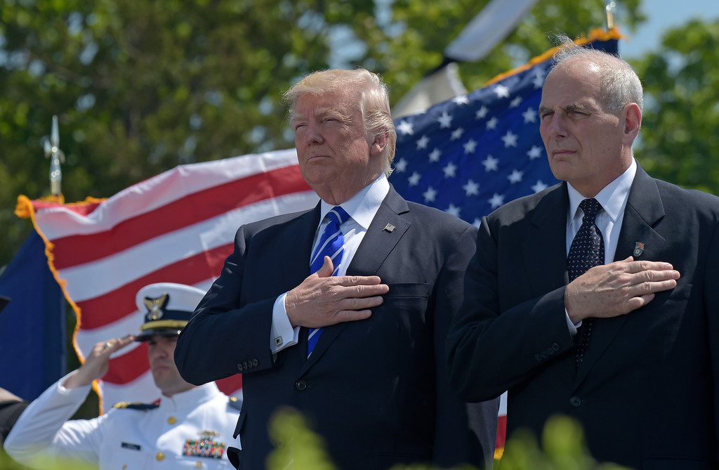 . File - President Donald Trump and Homeland Security Secretary John Kelly listen to the national anthem during commencement exercises at the U.S. Coast Guard Academy in New London, Conn., Wednesday, May 17, 2017. Trump named Kelly as his new Chief of Staff on July 28, 2017. (AP Photo/Susan Walsh)
