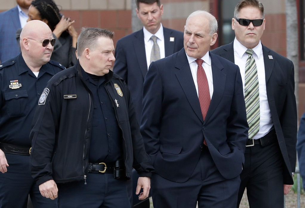 . Homeland Security Secretary John Kelly, center, walks with Director of Field Operations United States Customs and Border Protection Christopher Perry before a news conference at the Ambassador Bridge border crossing, Monday, March 27, 2017, in Detroit.  (AP Photo/Carlos Osorio)