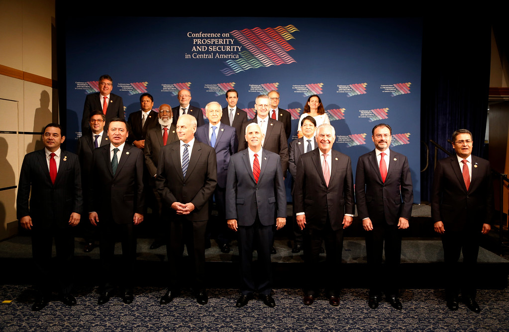 . Homeland Security Secretary John Kelly, third from left, Vice President Mike Pence, center, Secretary of State Rex Tillerson, third from right, the Foreign Secretary of Mexico Luis Videgaray, second from right, and the President of Honduras Juan Orlando Hernandez, right, pose for a group photo during a conference on Prosperity and Security in Central America, Thursday, June 15, 2017, in Miami. (AP Photo/Wilfredo Lee)