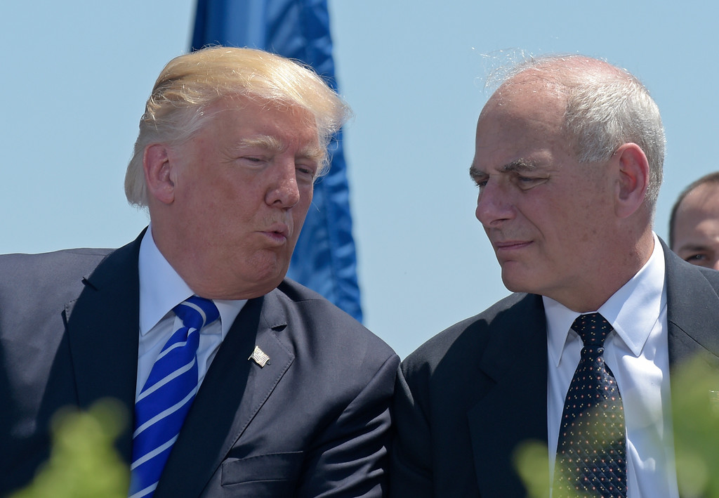 . FILE - In this May 17, 2017, file photo, President Donald Trump talks with Homeland Security Secretary John Kelly during commencement exercises at the U.S. Coast Guard Academy in New London, Conn. Trump named Kelly as his new Chief of Staff on July 28, ousting Reince Priebus. (AP Photo/Susan Walsh)