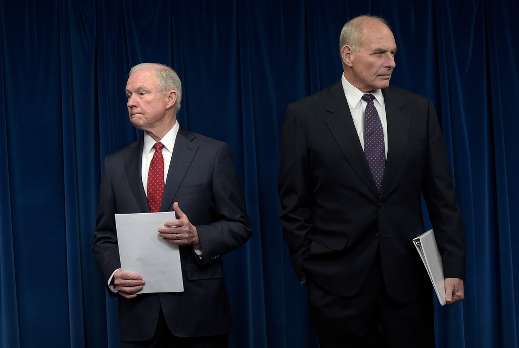 . Attorney General Jeff Sessions, left, and Homeland Security Secretary John Kelly, right, wait to make a statements on issues related to visas and travel, Monday, March 6, 2017, atthe U.S. Customs and Border Protection office in Washington. (AP Photo/Susan Walsh)