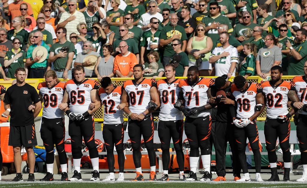 . The Cincinnati Bengals lock arms during the national anthem before an NFL football game against the Green Bay Packers Sunday, Sept. 24, 2017, in Green Bay, Wis. (AP Photo/Morry Gash)