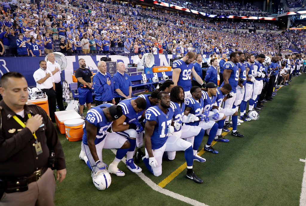 . Members of the Indianapolis Colts take a knee during the nation anthem before an NFL football game against the Cleveland Browns in Indianapolis, Sunday, Sept. 24, 2017. (AP Photo/Darron Cummings)