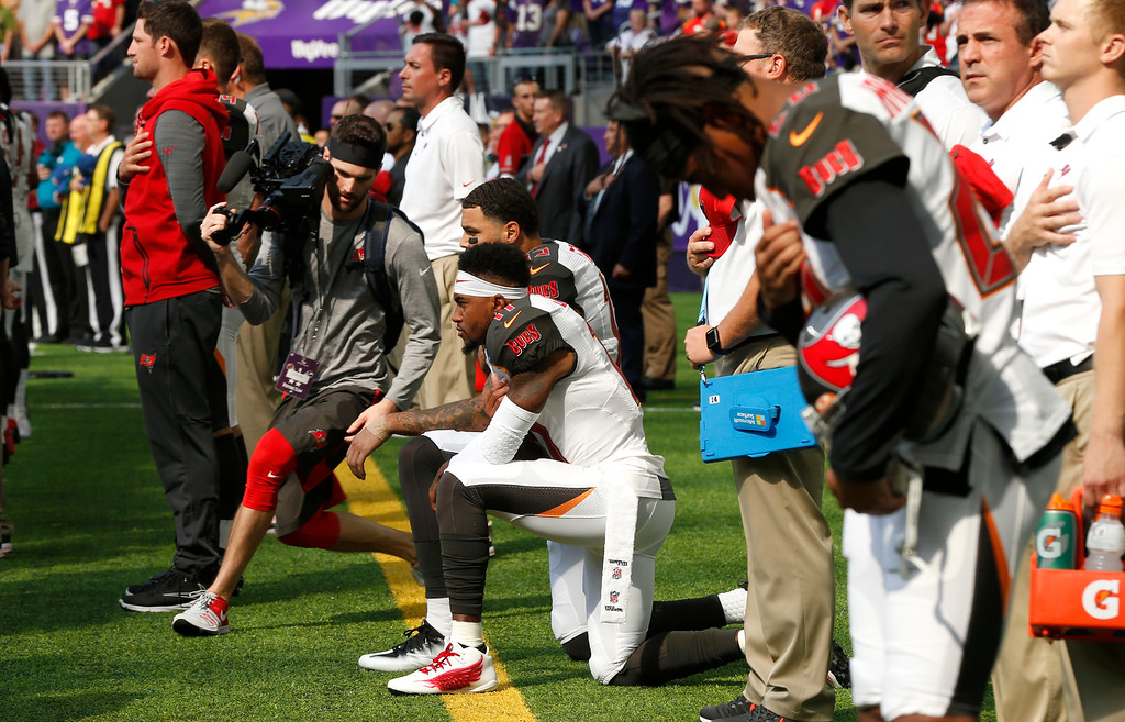 . Tampa Bay Buccaneers wide receiver DeSean Jackson, center, takes a knee during the national anthem before an NFL football game against the Minnesota Vikings, Sunday, Sept. 24, 2017, in Minneapolis. (AP Photo/Jim Mone)