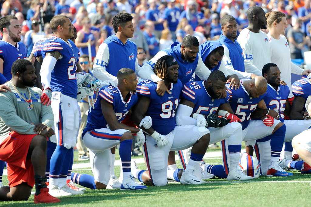 . Buffalo Bills players take a knee during the national anthem prior to an NFL football game against the Denver Broncos, Sunday, Sept. 24, 2017, in Orchard Park, N.Y. (AP Photo/Adrian Kraus)