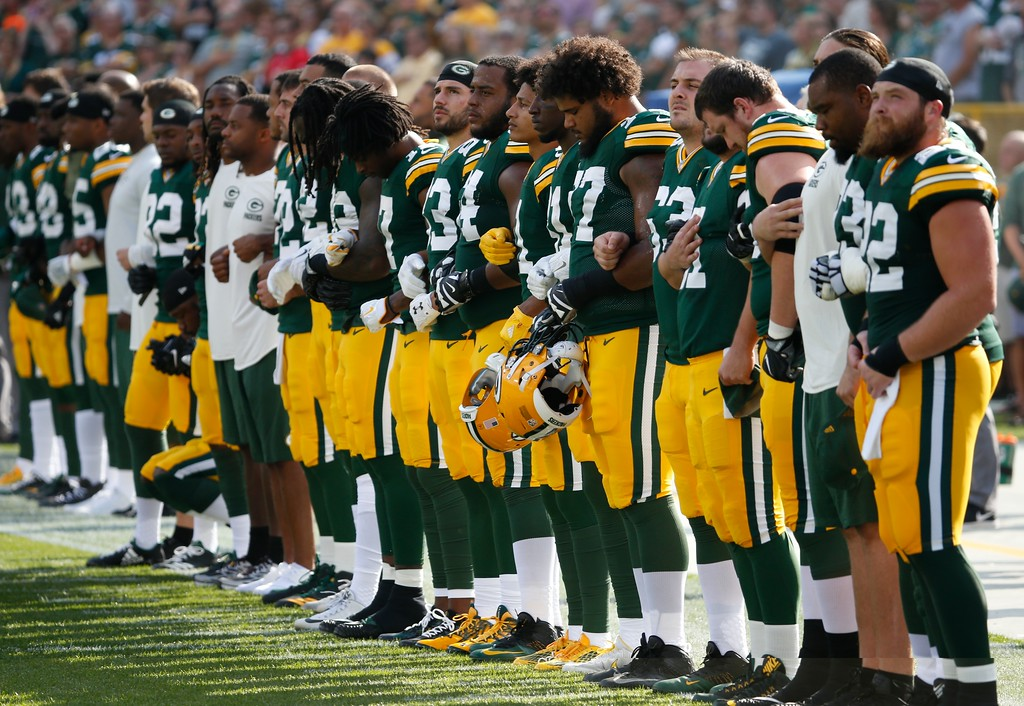 . Green Bay Packers players lock arms during the national anthem before an NFL football game against the Cincinnati Bengals Sunday, Sept. 24, 2017, in Green Bay, Wis. (AP Photo/Mike Roemer)
