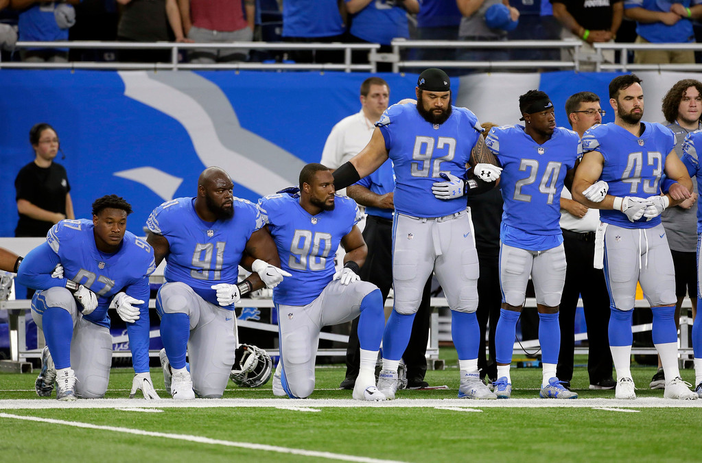 . Detroit Lions defensive end Armonty Bryant (97), defensive tackle A\'Shawn Robinson (91) and defensive end Cornelius Washington (90) take a knee during the national anthem before an NFL football game against the Atlanta Falcons, Sunday, Sept. 24, 2017, in Detroit. (AP Photo/Duane Burleson)