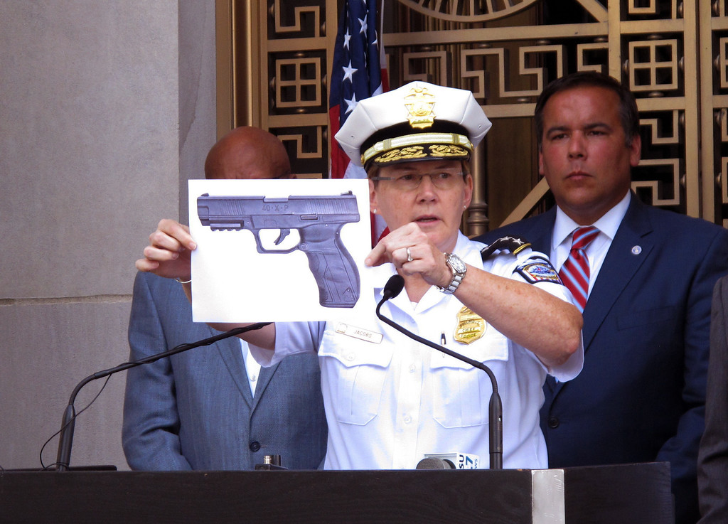 . Columbus Police Chief Kim Jacobs holds up a photo showing the type of BB gun that police say a 13-year-old boy pulled from his waistband just before he was shot and killed by police investigating an armed robbery report, on Thursday, Sept. 15, 2016 in Columbus, Ohio. Police say the boy, Tyree King, died at a hospital after the Wednesday evening shooting.  (AP Photo/Andrew Welsh-Huggins)