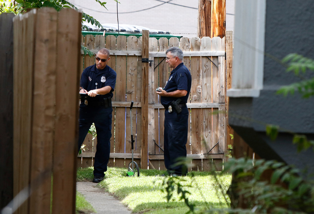 . Members of the Columbus Police Crime Scene Search Unit are seen behind a residence on  Hoffman Avenue on September 15, 2016, near the scene of a police shooting of 13-year-old Tyree King in Columbus, Ohio. An officer responding to reports of a robbery shot and killed a 13-year-old boy in Columbus, Ohio after he drew what turned out to be a BB gun, a type of air gun that shoots pellets, police said. The Columbus police department said it was investigating the death Wednesday night of Tyree King, the latest in a string of officer involved shootings that have fueled protests and national debate about policing tactics in US cities.  (PAUL VERNON/AFP/Getty Images)