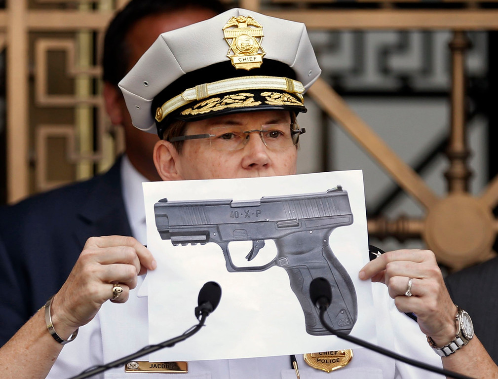 . Columbus Police Chief Kim Jacobs holds up a photo showing the type of BB gun that police say a 13-year-old boy pulled from his waistband just before he was shot and killed by police investigating an armed robbery report, on Thursday, Sept. 15, 2016 in Columbus, Ohio. Police say the boy, Tyree King, died at a hospital after the Wednesday evening shooting.   (Fred Squillante/The Columbus Dispatch via AP)