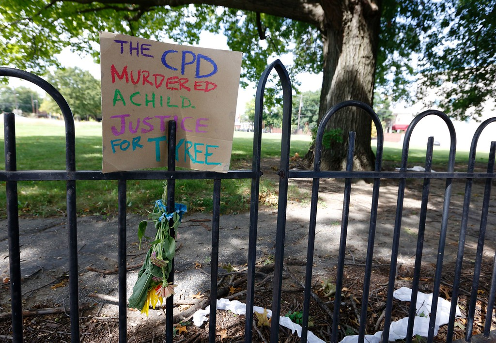 . A sign on a fence on 18th street near East Capital Street is seen September 15, 2016, near the scene of a  police shooting of 13-year-old Tyree King in Columbus, Ohio. An officer responding to reports of a robbery shot and killed a 13-year-old boy in Columbus, Ohio after he drew what turned out to be a BB gun, a type of air gun that shoots pellets, police said. The Columbus police department said it was investigating the death Wednesday night of Tyree King, the latest in a string of officer involved shootings that have fueled protests and national debate about policing tactics in US cities. (PAUL VERNON/AFP/Getty Images)