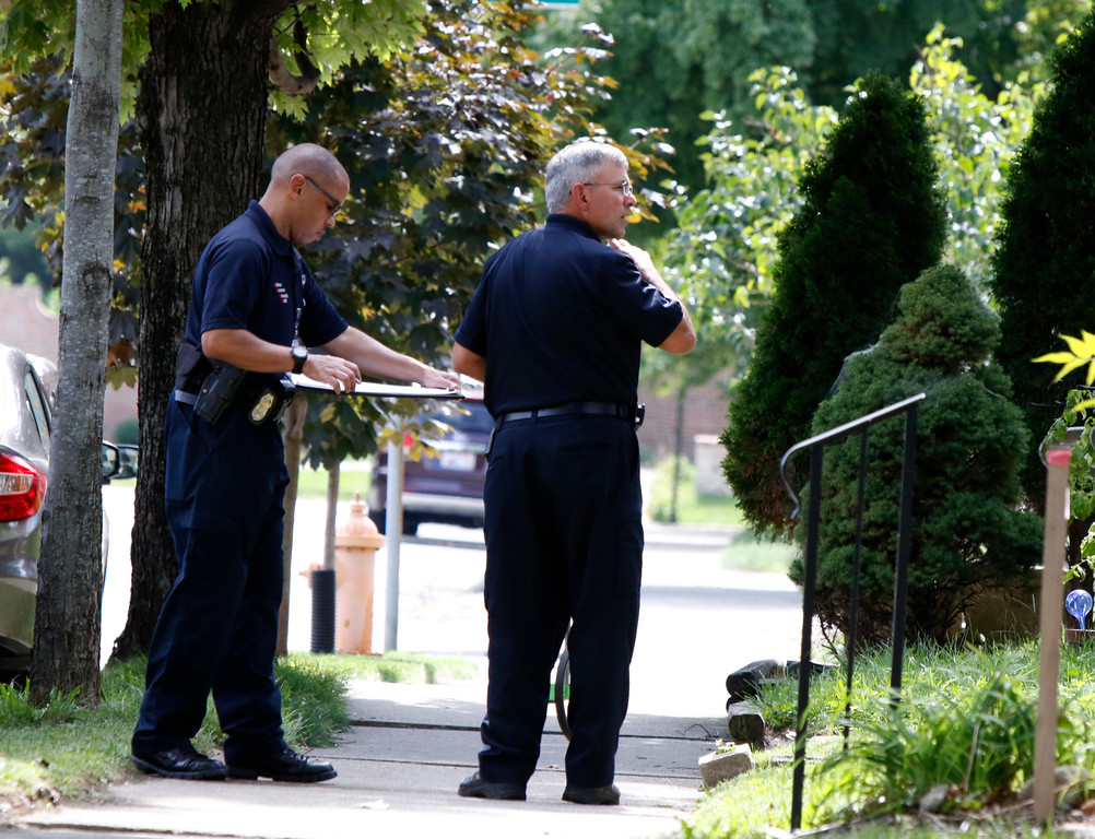 . Members of the Columbus Police Crime Scene Search Unit are seen on Hoffman Avenue on September 15, 2016, near the scene of a police shooting of 13-year-old Tyree King in Columbus, Ohio. An officer responding to reports of a robbery shot and killed a 13-year-old boy in Columbus, Ohio after he drew what turned out to be a BB gun, a type of air gun that shoots pellets, police said. The Columbus police department said it was investigating the death Wednesday night of Tyree King, the latest in a string of officer involved shootings that have fueled protests and national debate about policing tactics in US cities. (PAUL VERNON/AFP/Getty Images)