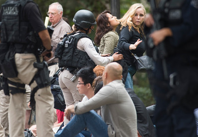 A woman reacts as she is searched by police outside of the engineering buildings after a murder-suicide Wednesday morning at UCLA left two dead, and prompted a campus-wide lockdown, according to the Los Angeles Police Department.. (Thomas R. Cordova/Southern California News Group)