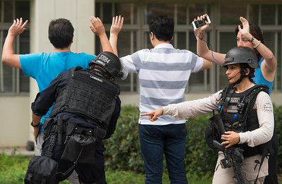 Police conduct a search on people coming out of the engineering buildings after a murder-suicide Wednesday morning at UCLA left two dead, and prompted a campus-wide lockdown, according to the Los Angeles Police Department.. (Thomas R. Cordova/Southern California News Group)