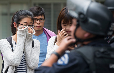A student covers her face as she reacts to the police outside of the engineering buildings after a murder-suicide Wednesday morning at UCLA left two dead, and prompted a campus-wide lockdown, according to the Los Angeles Police Department. (Thomas R. Cordova/Southern California News Group)