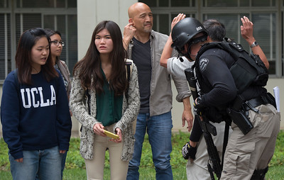 Students are searched after a murder-suicide Wednesday morning at UCLA left two dead, and prompted a campus-wide lockdown, according to the Los Angeles Police Department.   (Thomas R. Cordova/Southern California News Group)