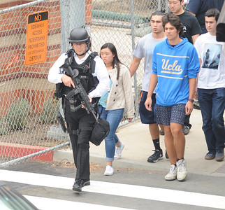 Law enforcement evacuate students at UCLA on Wednesday, June 1, 2016.  (Photo by Michael  Goulding/Orange County Register)