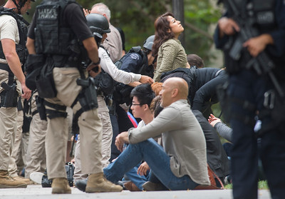 Students are searched after a murder-suicide Wednesday morning at UCLA left two dead, and prompted a campus-wide lockdown, according to the Los Angeles Police Department.. (Thomas R. Cordova/Southern California News Group)