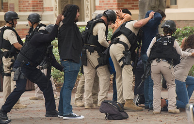 Police conduct a search on people coming out of the engineering buildings after a murder-suicide Wednesday morning at UCLA left two dead, and prompted a campus-wide lockdown, according to the Los Angeles Police Department. (Thomas R. Cordova/Southern California News Group)