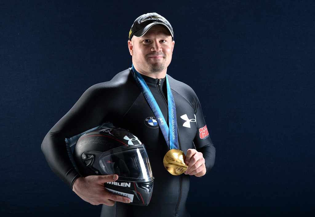 . In this April 26, 2013 file photo, bobsledder Steven Holcomb poses for a portrait with his gold medal during the USOC Portrait Shoot on April 26, 2013 in West Hollywood, California.  Holcomb, the longtime U.S. bobsledding star who drove to three Olympic medals after beating a disease that nearly robbed him of his eyesight, was found dead in Lake Placid, N.Y., on Saturday, May 6, 2017.  He was 37. (Photo by Harry How/Getty Images)