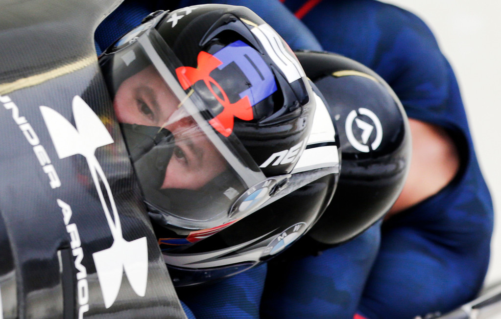 . FILE - In this Jan. 9, 2016 file photo, driver Steven Holcomb with Frank Delduca, Carlo Valdes and brakeman Samuel McGuffie, compete in the four-man bobsled World Cup race in Lake Placid, N.Y.  Holcomb, the longtime U.S. bobsledding star who drove to three Olympic medals after beating a disease that nearly robbed him of his eyesight, was found dead in Lake Placid, N.Y., on Saturday, May 6, 2017.  He was 37. (AP Photo/Mike Groll, File)